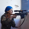 Kurdish YPJ Sniper almost hit by ISIS Sniper inside Raqqa. She just laughs it off.