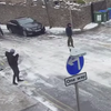 People struggling to walk up an icy hill in Swanage (Video)